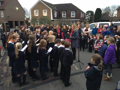 School choir singing at Christmas lights Event