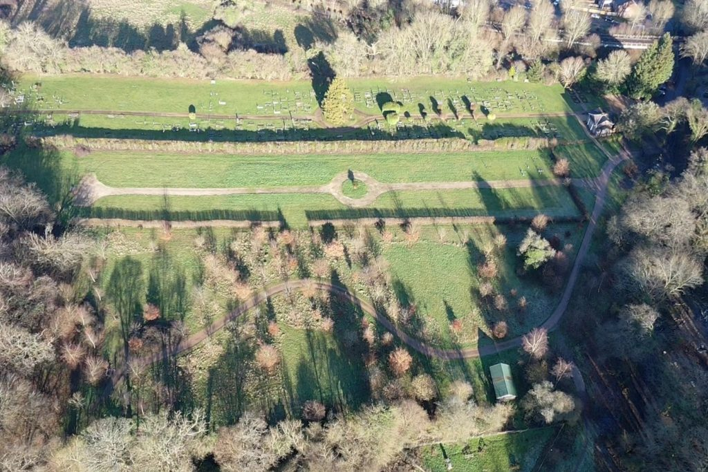 Overhead view of formal and woodland burial ground  showing chapel and tracks.